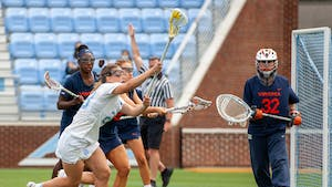 UNC senior defender Emma Trenchard (23) prepares to shoot the ball at the game against Virginia on Sunday Apr. 18, 2021 at the Dorrance Field. UNC won 15-4.