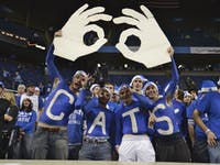 Kentucky fans cheer on the Cats during pregame warm-ups in Rupp Arena.
