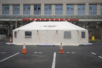 A tent stands outside the emergency wing of the UNC Medical Center on Monday, March 23, 2020. The tent was set up to keep coronavirus patients separated from other patients and hospital staff members.