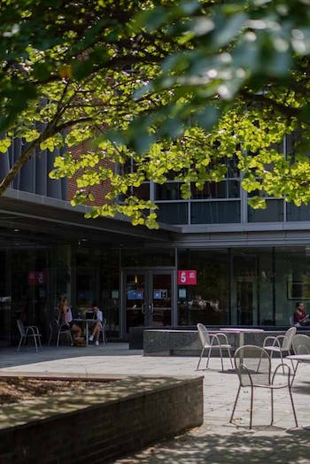 People sit at the tables outside of the FedEx Global Education Center, which houses several UNC global and cultural centers, on Tuesday, Sept. 8, 2020. The Asian American Center opened its doors virtually this week.