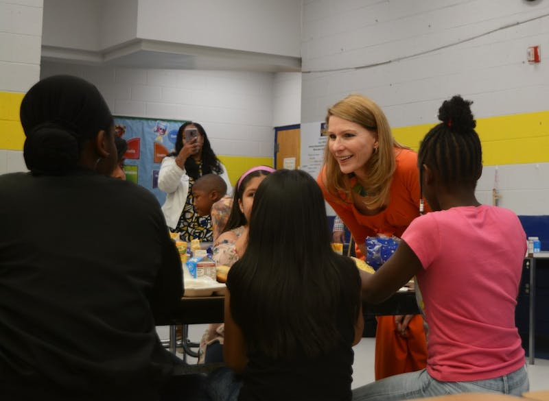 First Lady Kristin Cooper meets some of the ECDI summer program participants on Tuesday in Durham.