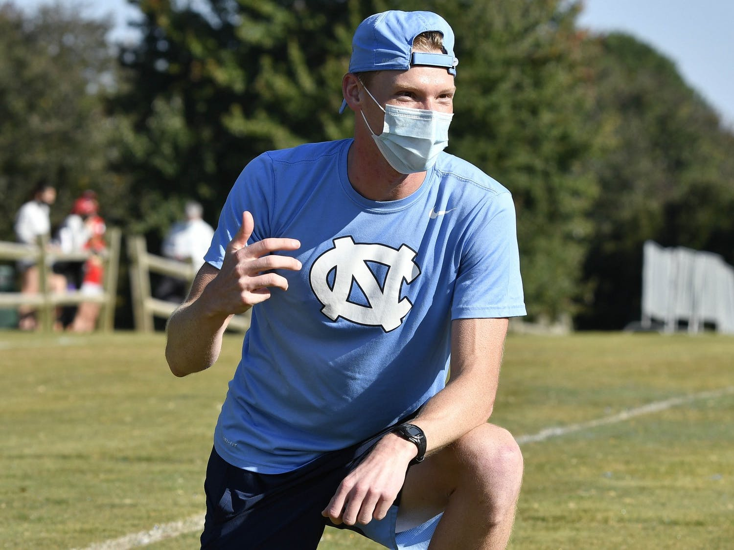 Dylan Sorensen coaches players at the University of North Carolina Cross Country Wolfpack Invite at the Wake Med Cross Country Course in Cary, NC on Wednesday, October 7, 2020. Photo courtesy of Jeffrey A. Camarati/UNC Athletic Communications.