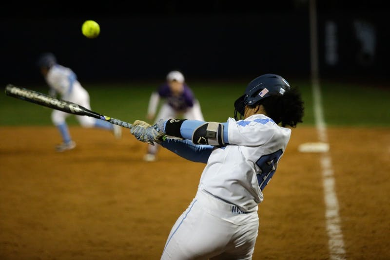 Hannah George (42) swings against Northwestern on Friday, Feb. 15, 2019 in Anderson Stadium.