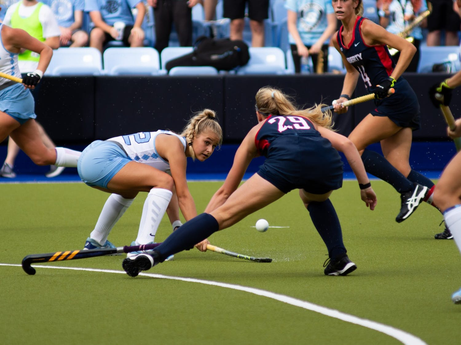 Freshman midfielder Jasmina Smolenaars (22) goes for the ball during UNC's Oct. 10 field hockey game against Liberty. The game proved to be a loss for the Tar Heels–Liberty headed home with a 4-0 win.
