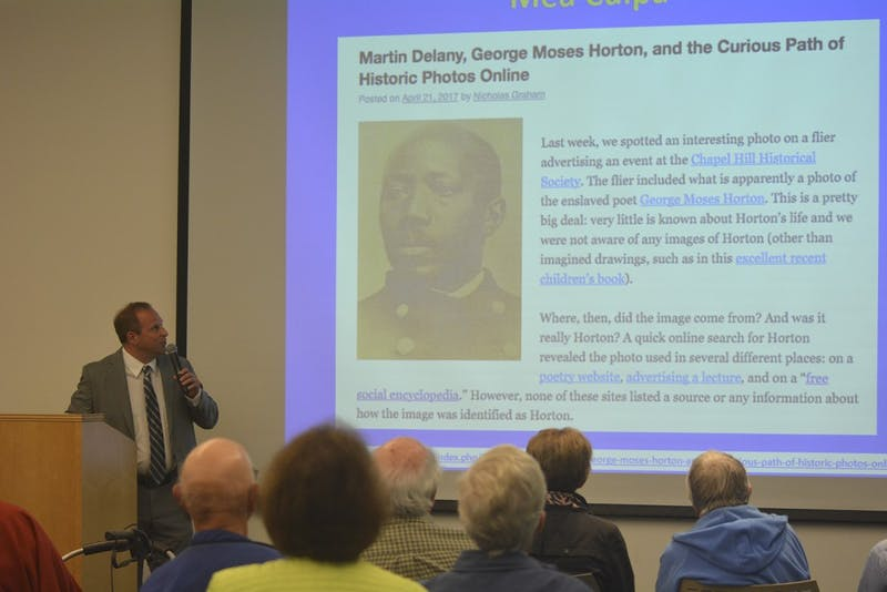 """Dr. Patrick Horn speaks at the Chapel Hill Historical Society """"Four Chapel Hill Writers Whose Lives Light Up Our Past"""" forum on Sunday afternoon"""