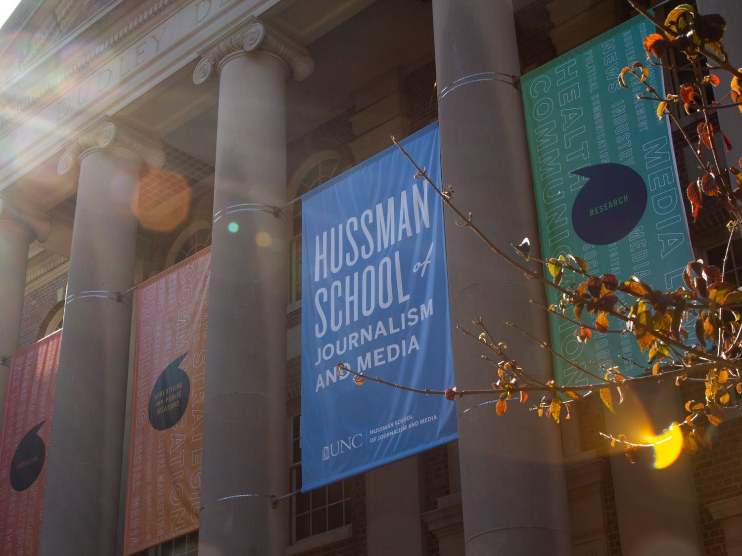 The banners hanging over Carrol Hall, home to UNC's Hussman School of Media and Journalism, on Nov. 11, 2020.