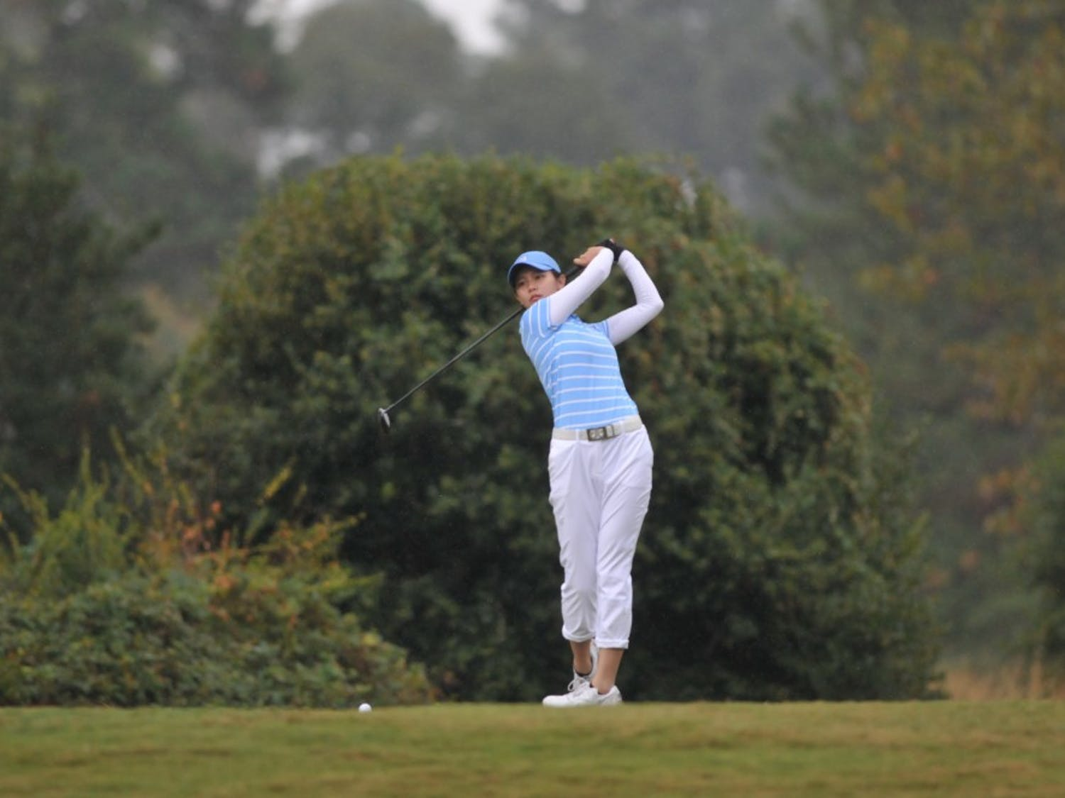 UNC sophomore Jennifer Zhou takes a practice swing at the Ruth's Chris Tar Heel Invitational on Sunday, Oct. 13, 2019. UNC placed sixth out of 18 teams at the three day tournament. Zhou finished 5th place overall, her second best in her collegiate career.