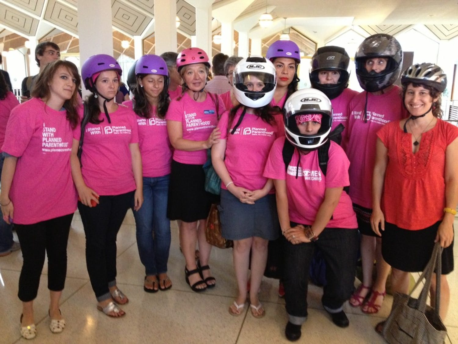 Pro-abortion rights activists sported motorcycle helmets at the N.C. General Assembly Thursday in recognition of state legislators' decision Wednesday to insert abortion clinic regulations into a motorcycle safety bill.