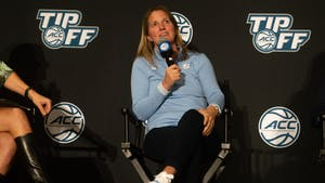 Women's basketball head coach Courtney Banghart speaks at the ACC Tipoff in Charlotte, NC, on Oct. 13.
