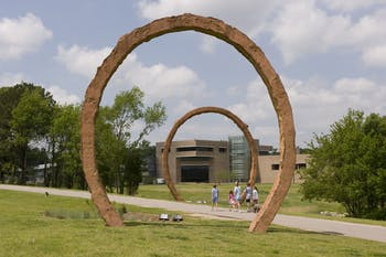 "Visitors walk by Thomas Sayre's sculpture ""Gyre"" at the North Carolina Museum of Art. The museum, among other organizations, has taken to social media to promote the arts. Photo courtesy of Kat Harding."