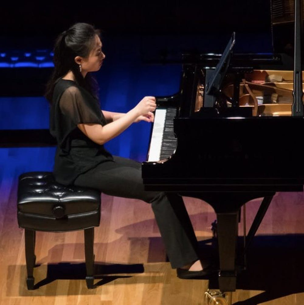 <p>UNC Associate Professor of Music and Head of Keyboard Studies Clara Yang performs on the piano. Yang will perform virtually alongside jazz pianist Aaron Diehl on June 4. Photo courtesy of Carolina Performing Arts.</p>