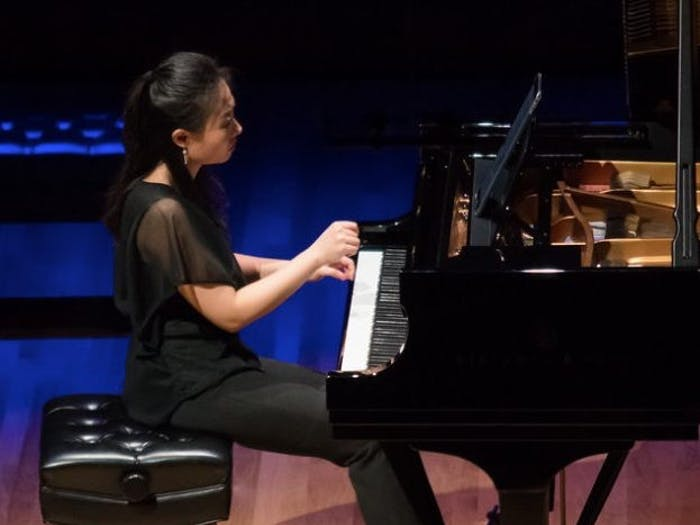 UNC Associate Professor of Music and Head of Keyboard Studies Clara Yang performs on the piano. Yang will perform virtually alongside jazz pianist Aaron Diehl on June 4. Photo courtesy of Carolina Performing Arts.