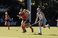 Freshman forward Erin Matson (1) Of UNC Field Hockey team battles for the ball against Syracuse in a 5-1 win on Saturday, Sept. 29, at Karen Shelton Stadium in Chapel Hill, NC.