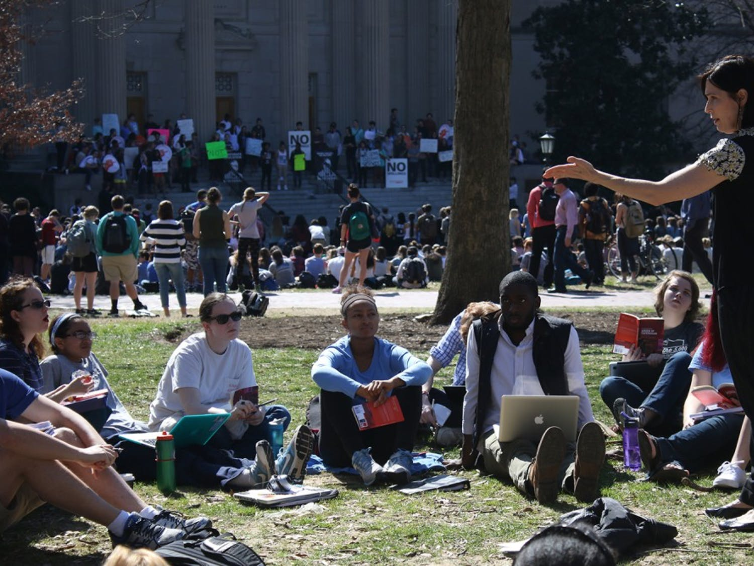 English professor Mary Floyd Wilson holds class outdoors during a walkout protesting Margaret Spellings appointment as UNC system president.
