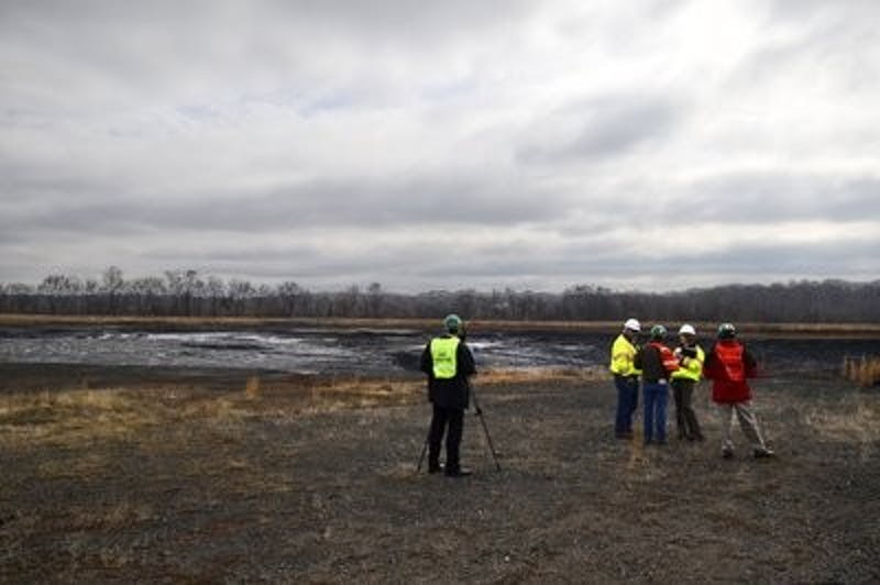 Duke officials took media members on a brief tour of the coal ash pond where an underground storm water pipe developed a break allowing water containing coal ash leaked into the Dan River at Eden, NC. (John D. Simmons/Charlotte Observer/MCT)