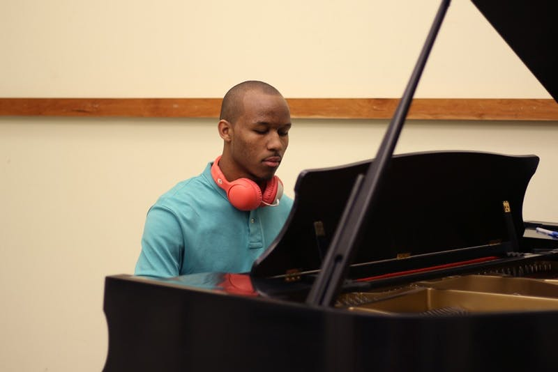 """Sophomore music major Chase Carroll plays the piano. Carrol is releasing his album """"The Perfect Problem"""" on Mar. 26."""