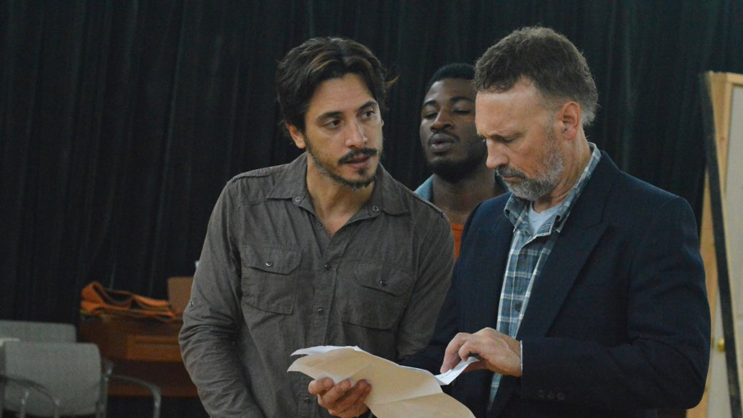 Ariel Shafir, Tristan Parks, and Jeffrey Cornell discuss important documents during rehearsal for Playmakers rendition of The Crucible in the Center of Dramatic Art on Wednesday, Oct. 5th.  The Crucible debuts on Oct. 19th, 2016.