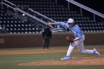 Tyler Baum (23) pitches against Liberty University on March 3 at Boshamer Stadium.