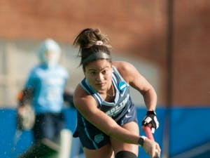 Junior back Courtnie Williamson (25) passes the ball during the NCAA Championship Game against Princeton University at Kentner Stadium on Sunday, Nov. 24, 2019. UNC won 6-1, marking their 8th national championship.