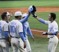 North Carolina third baseman Kyle Datres (3) celebrates after hitting a home run against Coastal Carolina on March 28.