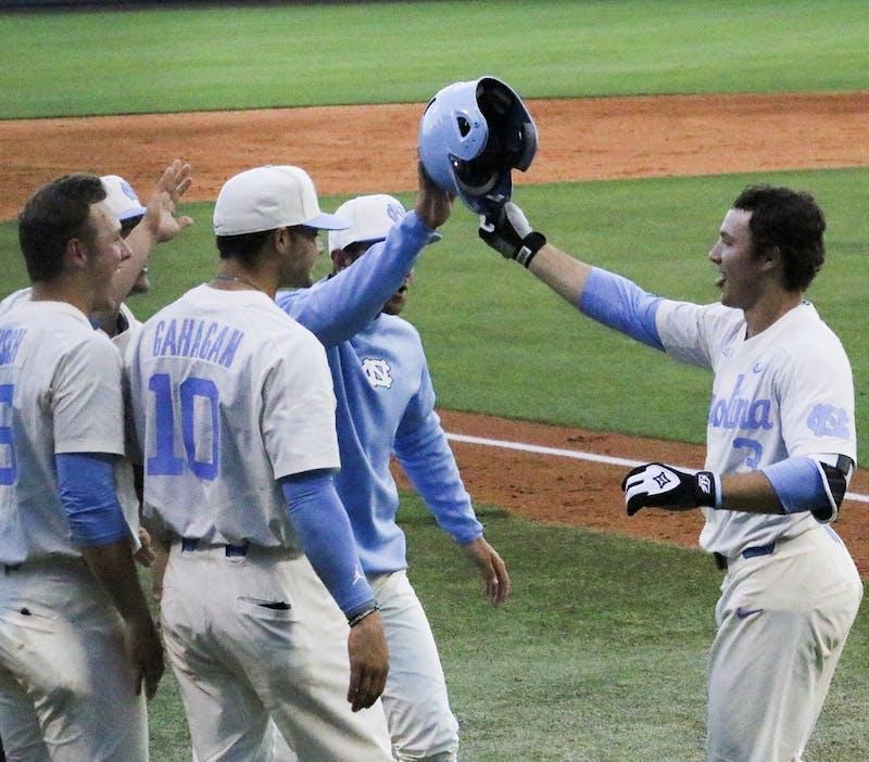 North Carolina third baseman Kyle Datres (3) celebrates after hitting a home runagainst Coastal Carolina on March 28.