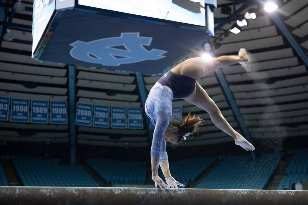 <p>Sophomore Emery Summey performs her balance beam routine during a meet against George Washington in Carmichael Arena on Friday, Feb. 28, 2020. The Tar Heels placed first against the Colonials.</p>