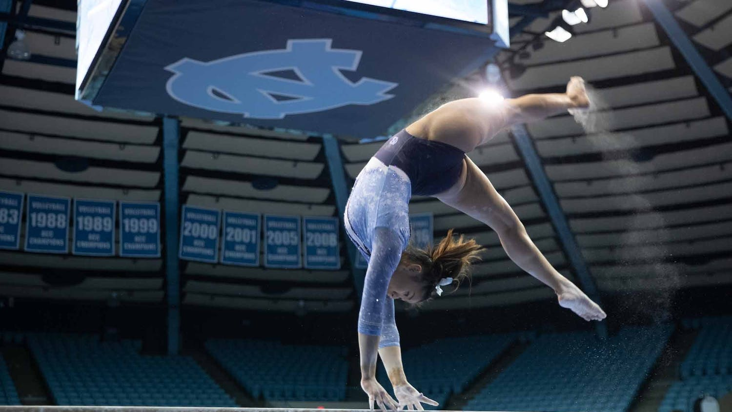 Sophomore Emery Summey performs her balance beam routine during a meet against George Washington in Carmichael Arena on Friday, Feb. 28, 2020. The Tar Heels placed first against the Colonials.