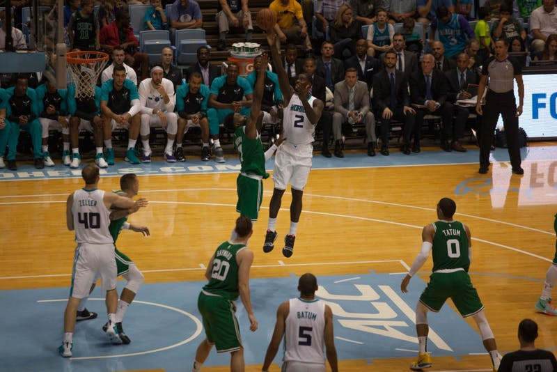 Hornets forward Marvin Williams (2) shoots against Celtics forward Jaylen Brown (7) at the Smith Center Sept. 29. The Charlotte Hornets defeated the Boston Celtics, 104-97, in a preseason game.
