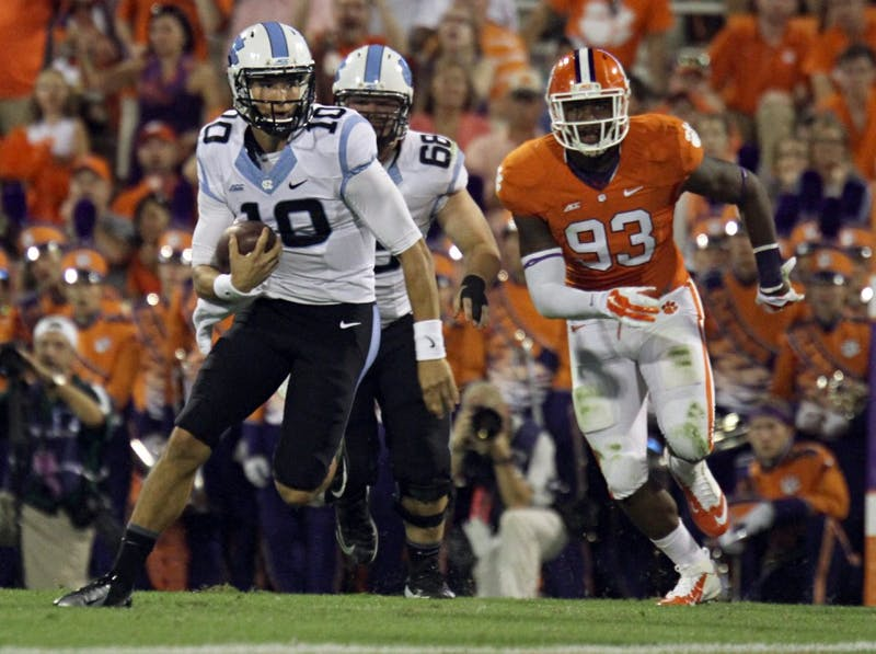 UNC's Mitch Trubisky (10) runs the ball up the middle of the field during the UNC - Clemson game September, 20 . Trubisky rushed for 13 yards.