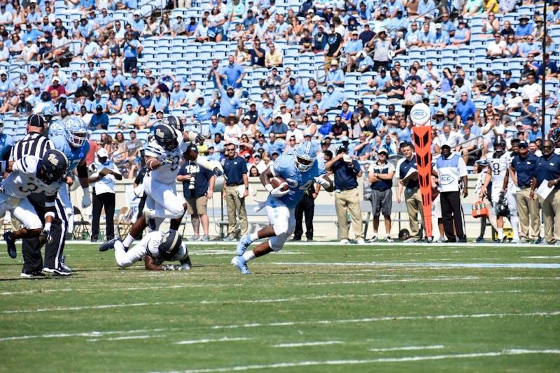Tailback Antonio Williams (24) escapes Pitt's defense to score a touchdown. UNC won 38-35 vs. Pitt on Saturday, Sept. 22 2018.