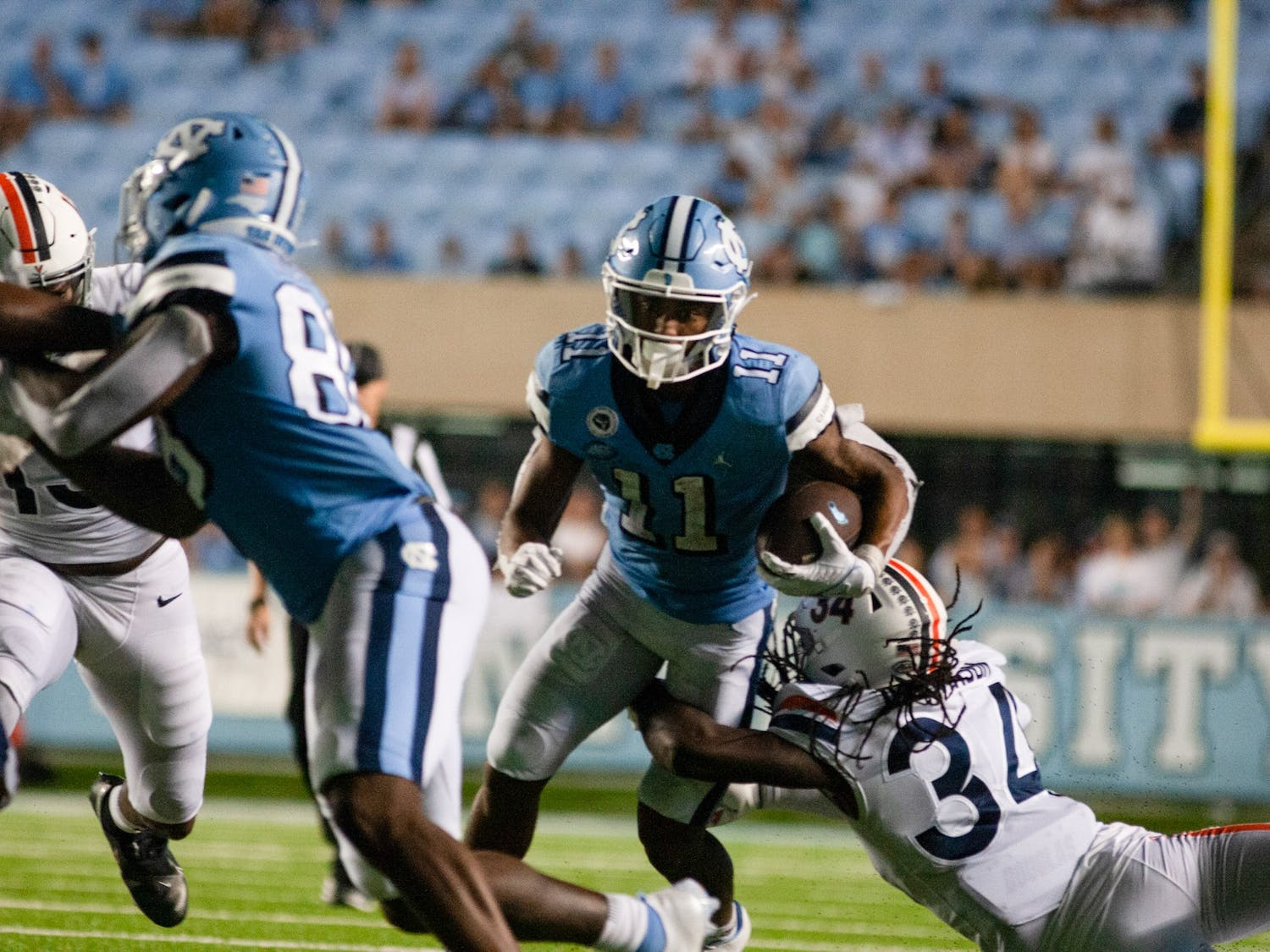 UNC sophomore wide receiver Josh Downs (11) rushes the ball down the field in the first quarter against the University of Virginia. UNC defeated the Cavaliers 59-39, their second win of the season.