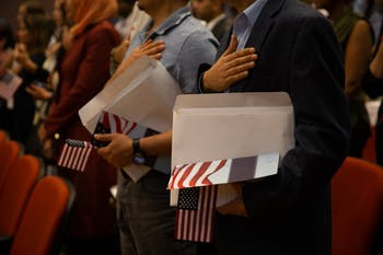 Soon-to-be citizens sing the national anthem at the naturalization ceremony on April 12, 2019 at the FedEx Global Education Center.