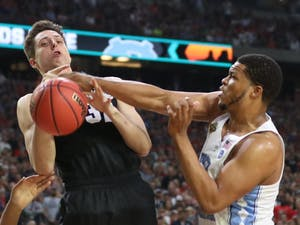 Meeks (3) swats the ball from Gonzaga forward Zach Collinas (32) in the first half of the NCAA final.