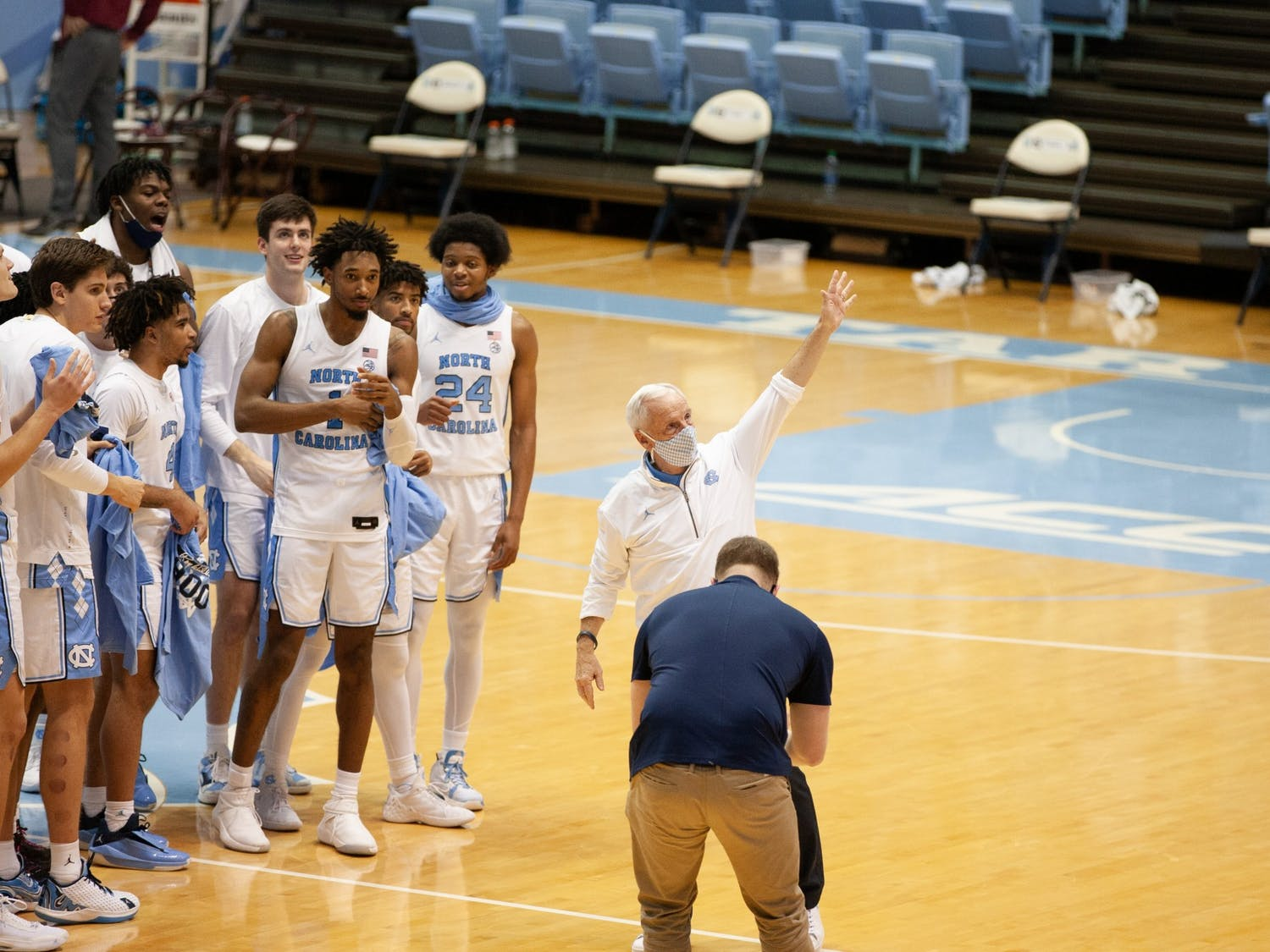 UNC head coach Roy Williams waves to the crowd following Carolina's 78-70 victory over Florida State in the Smith Center, Feb. 27, 2021. The victory was Williams' 900th as a head coach.