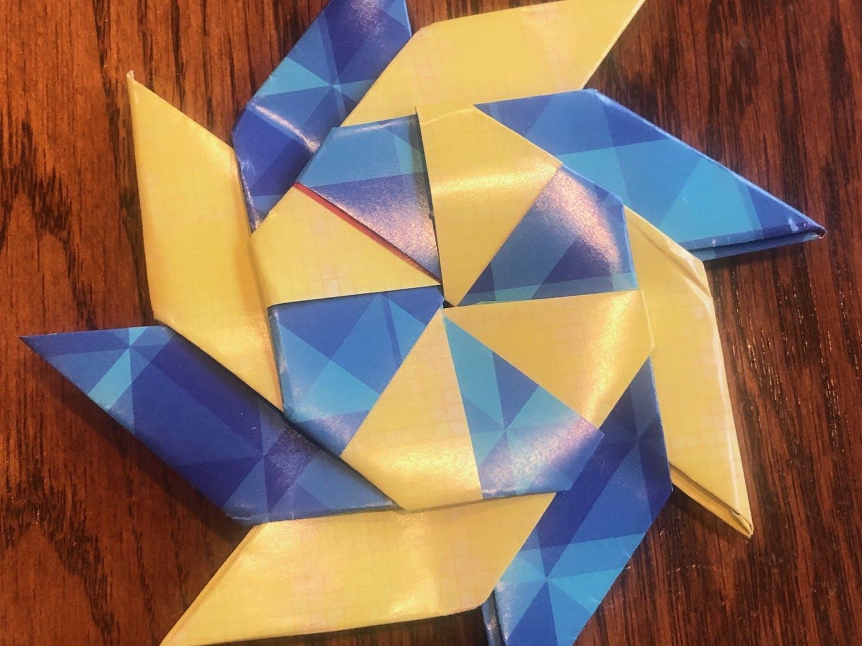 Origami transformational pinwheel made by Aaron Sugarman.
