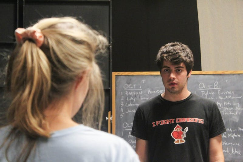 "First-year Logan Kelly, a psychology and vocal performance major, rehearsing for ""Circle Mirror Transformation"" with junior LJ Enloe, a computer science and dramatic art major."