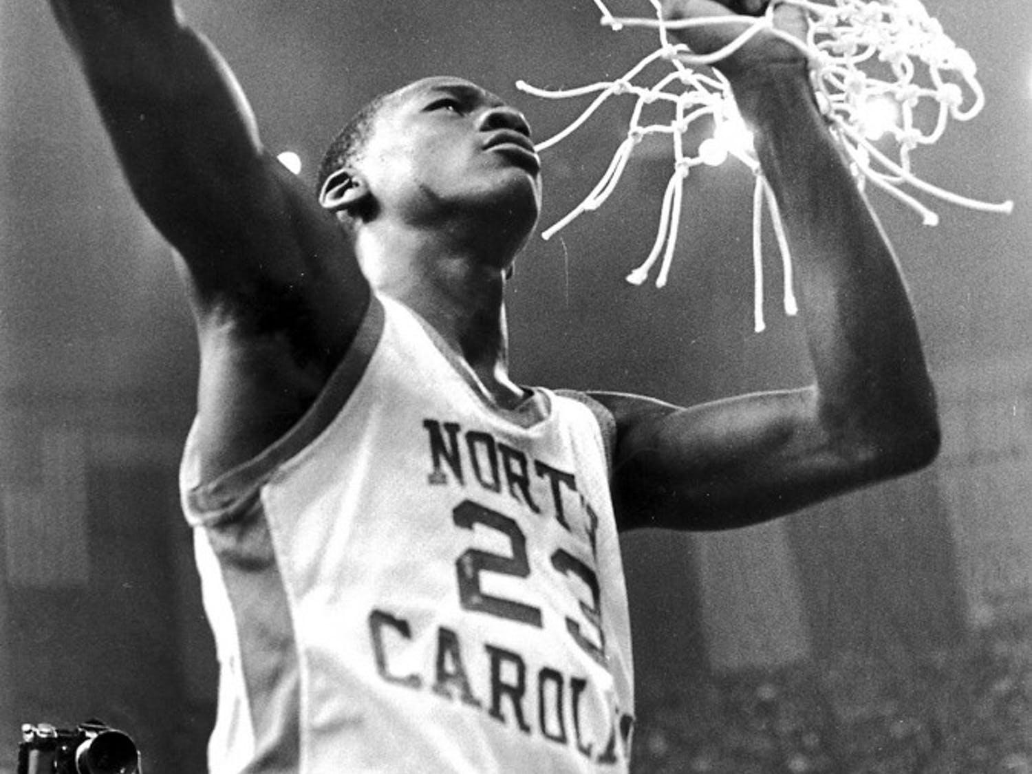 Michael Jordan helps cut down the nets after the 1982 NCAA National Championship. Courtesy of UNC Athletic Communications