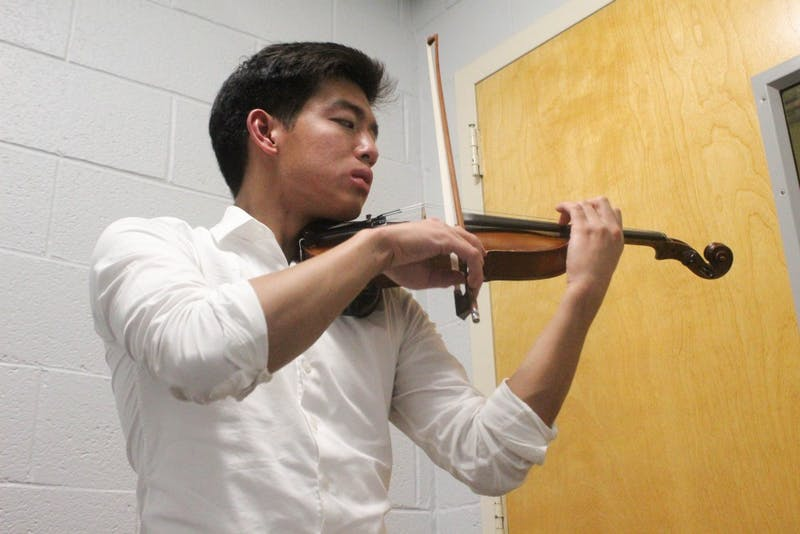 "Junior biology major Thoai Vu practicing the violin in Hill Hall on Tuesday, Oct. 22, 2019. Vu is the president and founder of Heeling in Harmony. Vu said that the club ""aims to promote healing and improve quality of life through music and music related activities."""