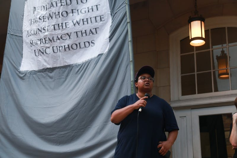 UNC graduate student Maya Little speaks to the crowd of protestors at Peace and Justice Plaza on Franklin St.