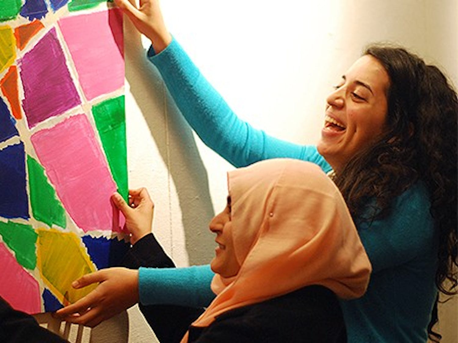 A group of UNC students are having a multimedia exhibition in the union on Wednesday. Features Muslims in the Triangle as they pursue their passions or interests. From left, Aisha Anwar,sophomore, and Layla K Quran, junior, are running the event.