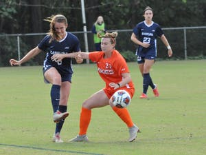 Defender Julia Ashley (16) fights for the ball against Virginia Tech midfielder Kristina Diana (22) in the ACC Tournament quarterfinals on Oct. 28 at WakeMed Soccer Park in Cary. UNC defeated Virginia Tech 2-0 to advance to the semifinals.