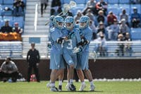 UNC junior midfielder William Perry (3) celebrates after scoring a goal with teammates Justin Anderson (21) and Andy Matthews (12) during UNC's 12-10 home loss against the University of Denver on Saturday, March 3, 2019 at the UNC Soccer and Lacrosse Stadium in Chapel Hill, N.C. This was the UNC Men's Lacrosse team's inaugural game at the UNC Soccer and Lacrosse Stadium.
