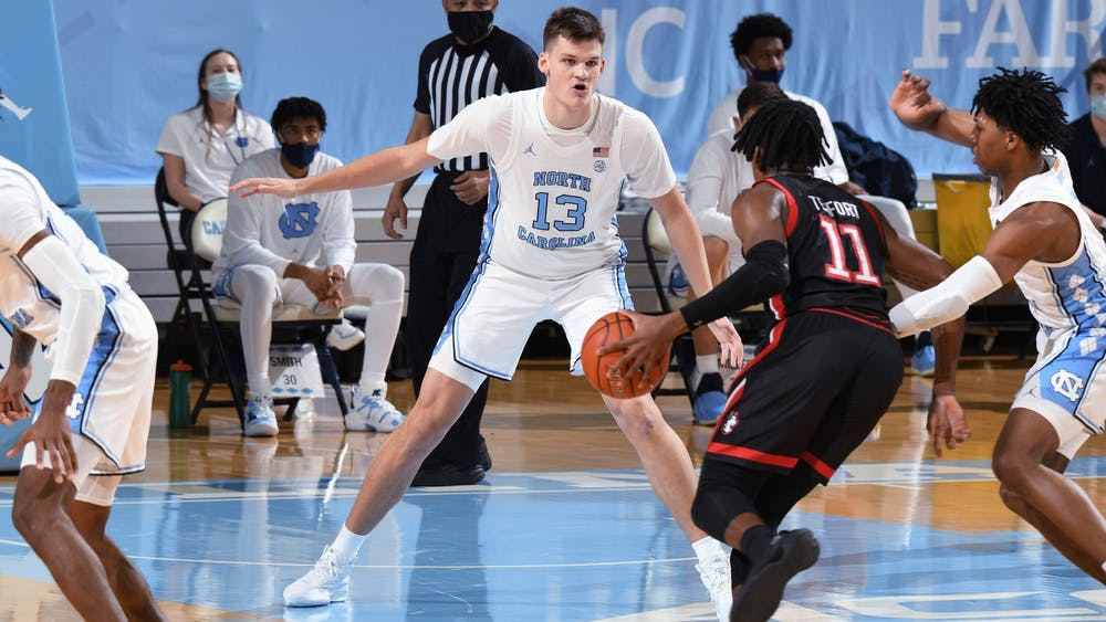 UNC first year Walker Kessler (13) defends against Northeastern during a game in the Smith Center on Wednesday, February 17, 2021. Photo courtesy of Jeff Camarati.