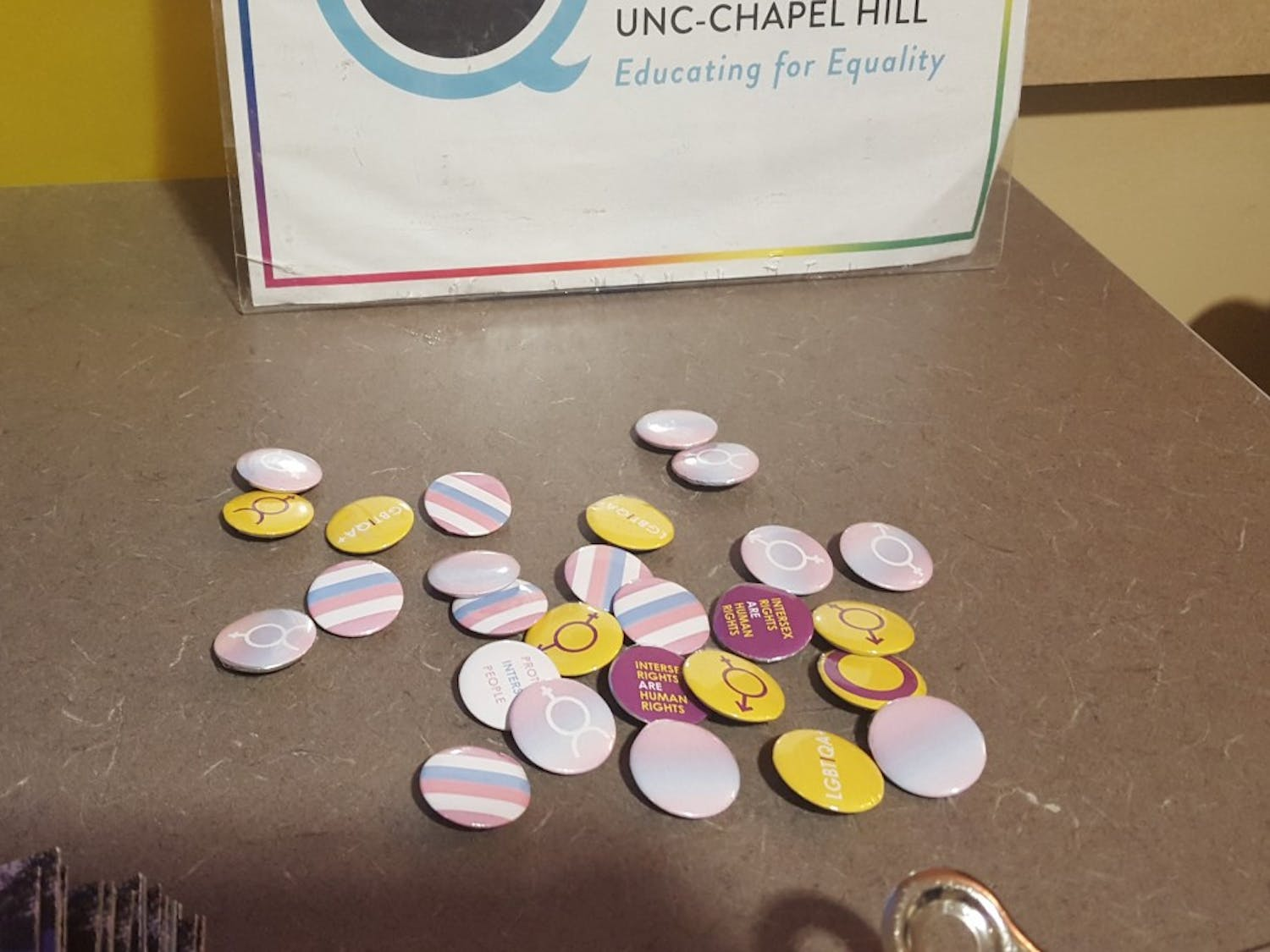 The LGBTQ center handed out buttons for intersex awareness and acceptance.