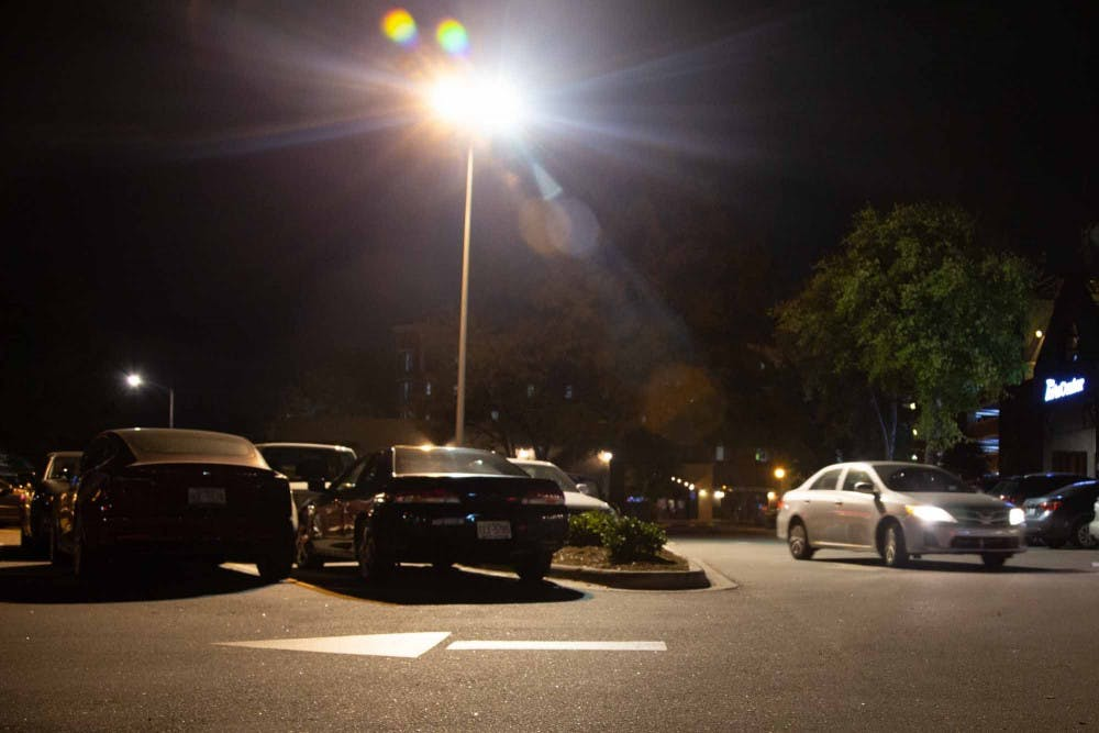 <p>A car drives by the parking lot on 300 E. Main St. on Oct. 7, 2019. Carrboro is hiring a consultant to review its options regarding parking. Some of the options are paid parking, more enforcement and a parking deck.</p>