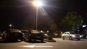 A car drives by the parking lot on 300 E. Main St. on Oct. 7, 2019. Carrboro is hiring a consultant to review its options regarding parking. Some of the options are paid parking, more enforcement and a parking deck.