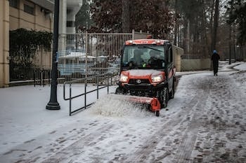 A snow plow goes around Kenan Stadium to clear pathways.