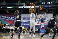 Redshirt senior guard Paris Kea (22) takes a shot during UNC's first game in the ACC tournament against Georgia Tech in Greensboro, N.C. on Thursday March 7, 2019. UNC defeated the Yellow Jackets 80-73 to move on to the next round of the tournament.