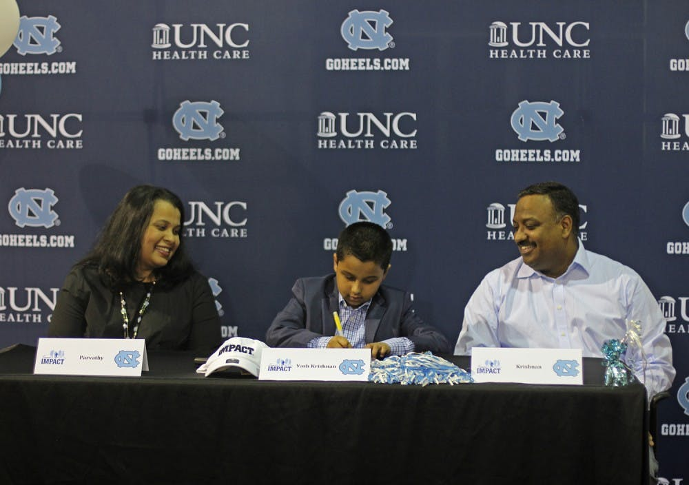Selfless 8-year-old Yash Krishnan 'signs' with UNC cross country