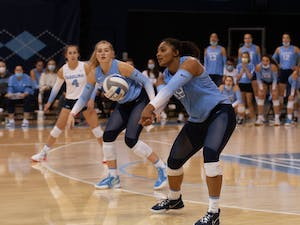 Graduate outside hitter Nia Robinson (18) prepares to receive the ball and pass to a teammate in an intense match against Wake Forest at Carmichael Arena on Oct. 8. The Tar Heels defeated the Demon Deacons 3-2.